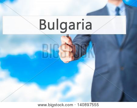Bulgaria - Businessman Hand Holding Sign