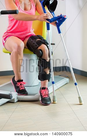 Young Woman Wearing A Brace On Her Leg