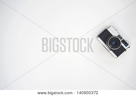 Vintage photo camera on wood white, Thailand