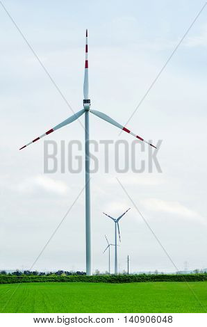 Wind turbine in field. Group of wind turbine. A windfarm or wind park is a group of wind turbines in the same location used to produce electricity.