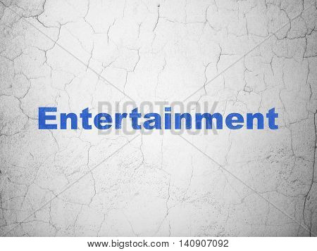 Entertainment, concept: Blue Entertainment on textured concrete wall background