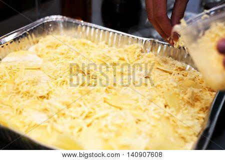 Closeup of baked potatoes with cheese. Potato gratin