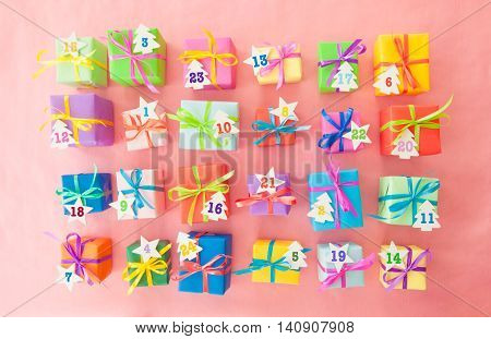 Many colorful gifts wrapped in bright paper with little ribbons