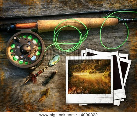 Fly fishing rod with instant photo pictures on wood background