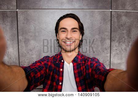 Joyfull Young Man Makes Selfie Photo And Smiling