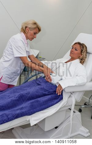 TENERIFE, SPAIN, JULY 2014: : Aesthetic medicine and cosmetology. Woman getting rf lifting procedure in a beauty clinic on Adeje Sur.
