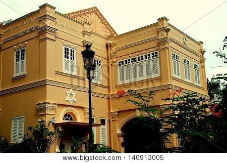 Singapore - December 13 2007: The historic Maghain Aboth Synagogue with white louvered shutter windows and bas relief Stars of David on Waterloo Road