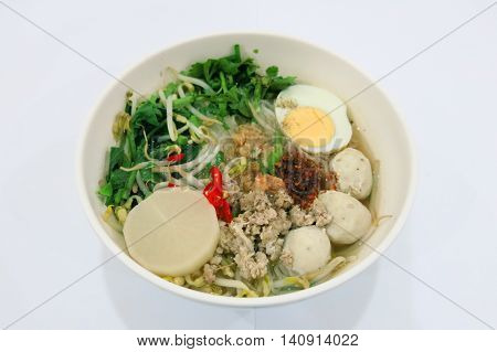 Pork Noodle mix with Pork chop Meat ball Celery Coriander Shallot Bean sprouts boiled egg Radish Thai herb and Seasoning etc.