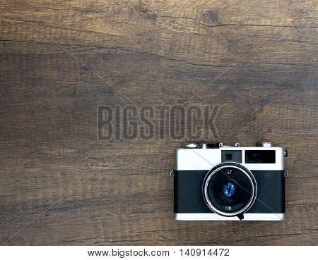 Vintage photo camera on wood , Thailand