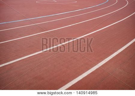 Red running track in stadium for athlete, jogging, relax, walk and running