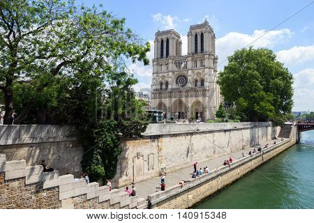 PARIS - JUNE 19 2015: The Notre Dame Cathedral is located in the heart of Paris and is one of its most popular attractions of the city.