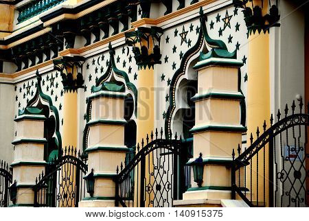 Singapore - December 17 2007: Saracen columns and iron gates enclose the ornate facade decorated with stars at the 1907 Masjid Abdul Gaffoor Mosque in Little India
