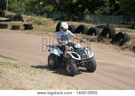 Man Drives Karting Car On Outdoor Track