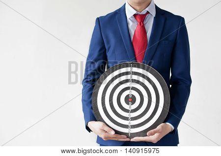 Businessman Holding Dartboard - Business Targeting Concept