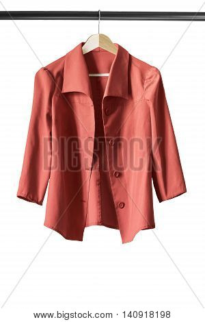 Red jacket on wooden clothes rack isolated over white