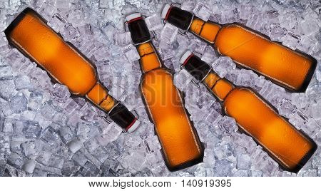 Set of bottles of beer with drops in ice isolated on white background.