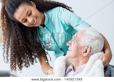 Caregiver And Elderly Man Smiling To Each Other