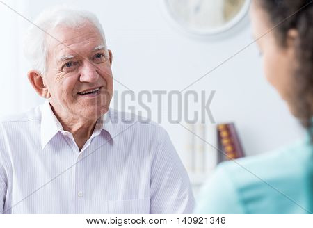 Senior Man Talking To Caregiver