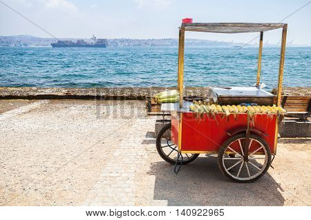 Red Selling Cart With Boiled Corn