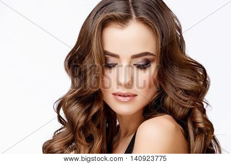 Beautiful Face of Young Woman with Clean Fresh Skin close up on light grey background. Beauty Portrait. Beautiful Woman Smiling. Perfect Fresh Skin. Pure Beauty Model. Youth and Skin Care Concept