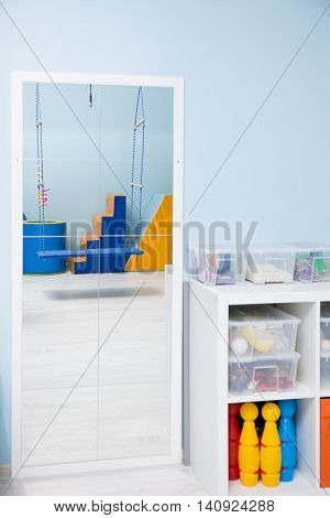 Rack with sensory therapy equipment and a mirror