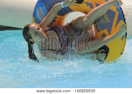 Rhodes Greece-July 31 2016:The girl on the rafting slide in the Water park.Rafting slide is one of many popular game for adults and children in park.Water Park is located on the island of Rhodes in Greece and one of the largest in Europe