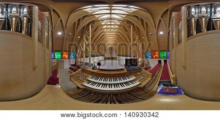 SUB CETATE, ROMANIA - July 17: 360 panorama from organist's point of view of the interior of Saint Joseph Catholic Church in Zeteváralja (Sub Cetate), Transylvania, Romania.