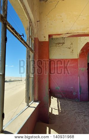 Abandoned ghost diamond town of Kolmanskop in Namibia which is slowly being swallowed by the desert. Africa