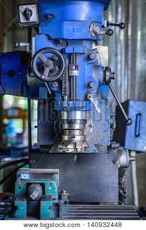 Detail of Milling machine in factory workshop.