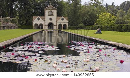 CONWY, WALES, JUNE 27. Bodnant Garden on June 27, 2016, near Conwy, Wales. Visitors to Bodnant Garden near Conwy Wales enjoy the Pin Mill and Lily Pond.