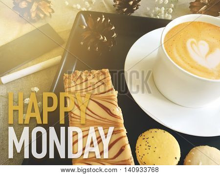 Happy Monday word on coffee with dessert background