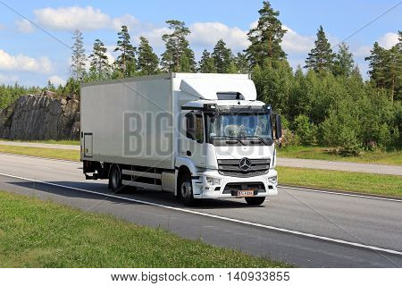 PAIMIO, FINLAND - JULY 1, 2016: New white Mercedes-Benz Antos truck moves along motorway in South of Finland on a sunny day of summer.