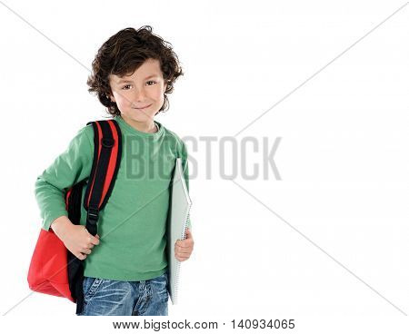 Smiling little boy with backpack and schoolbooks