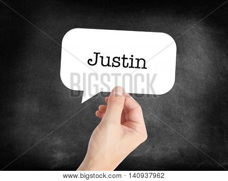 Justin written in a speechbubble
