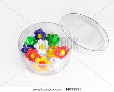 Colorful flower push pins against a soft background