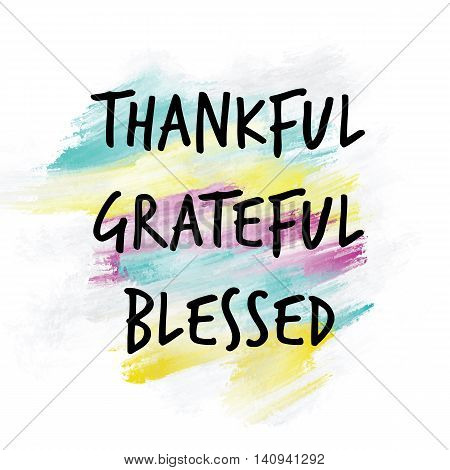 Thankful, grateful, blessed written on colorful painted background