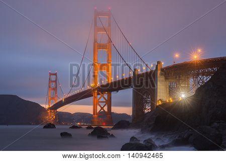 Marshall Beach  National Recreation Area, San Francisco, California, USA. Lights and Fog on the world's ninth longest suspension bridge.