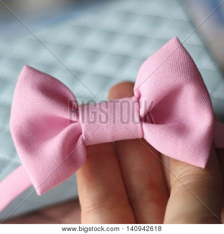 Pink color bow tie close up