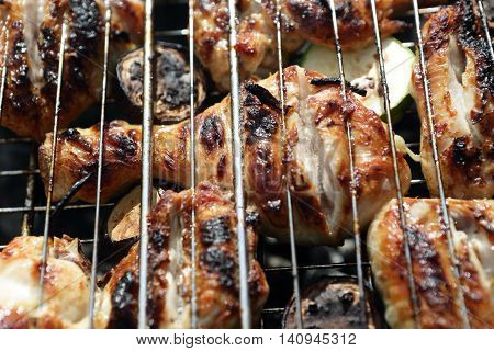 Chicken Legs With Zucchini On Grill Grate