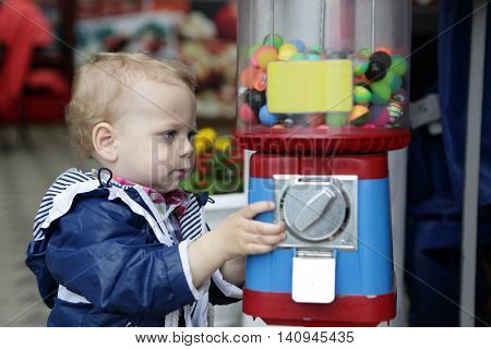 Child using vending toys on the street