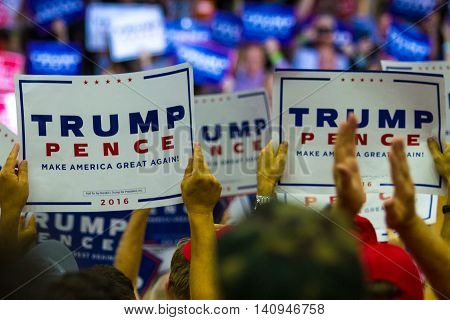 Mechanicsburg PA - August 1 2016: Supporters of Presidential candidate Donald J. Trump wave signs during a political rally.