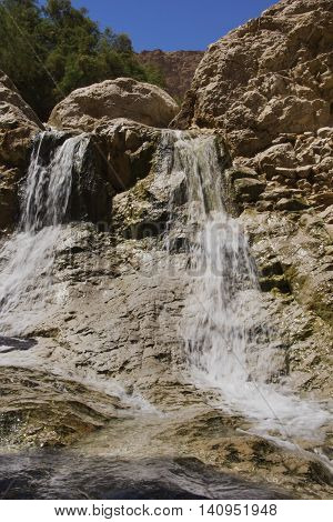 Waterfall on the river in the middle of the desert - an oasis