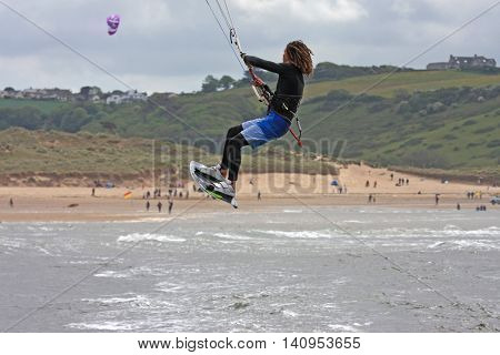 kitesurfer jumping off Bantham beach in Devon