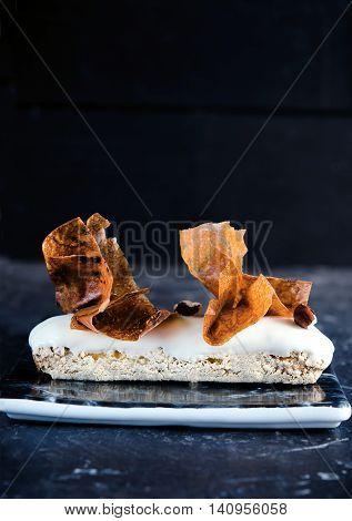Delicious vanilla eclair with vanilla-praline and vanilla Chantilly Tahiti, decor, crunchy flakes Gavotte