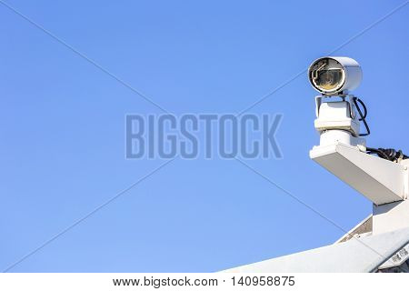 CCTV security camera over blue sky