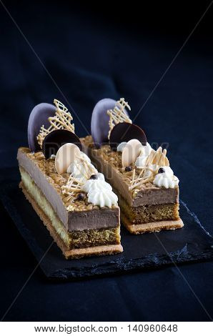 Chocolate mousse cake with coffee cream and crispy layer