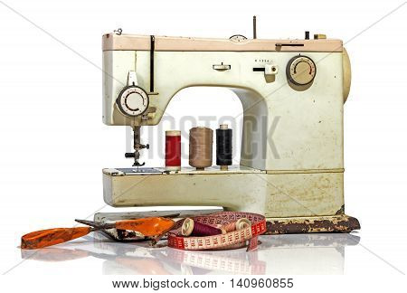 Old Rusty Vintage Sewing Machine With Scissors And Tape Measure