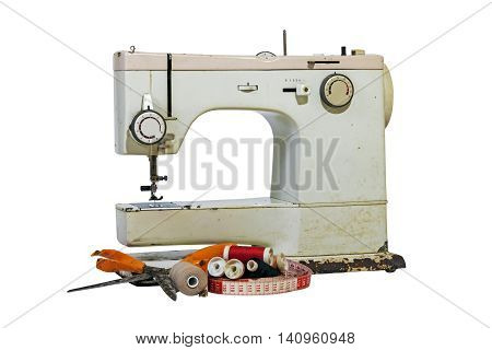 Old Rusty Vintage Sewing Machine With Cotton And Scissors