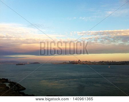 Panoramic view of San Francisco bay area, ocean and colorful sky background