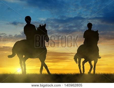 Silhouette two riders on horse at sunset.